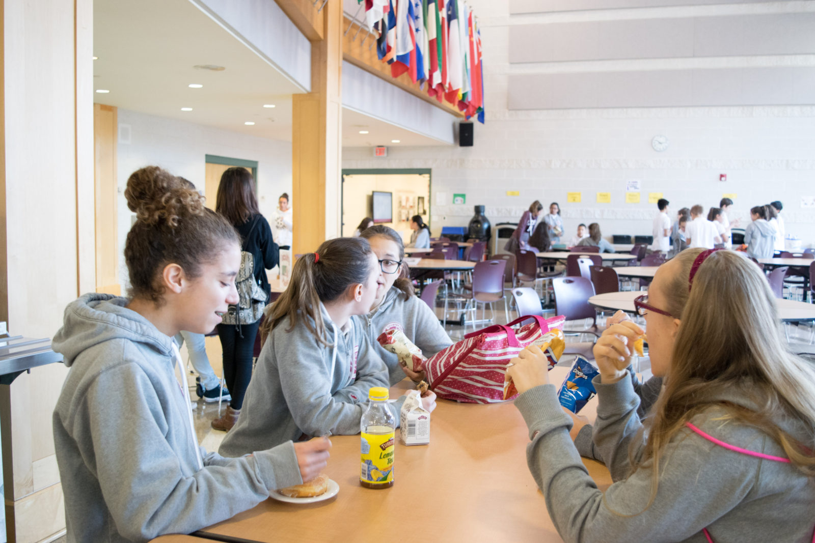 Seventh graders enjoy a small snack at 10 a.m. break.